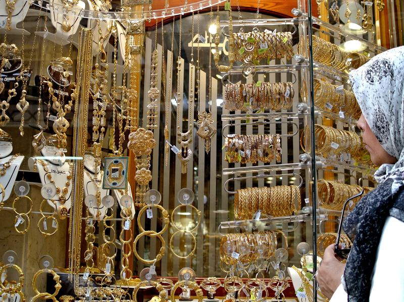 A woman looks at gold jewelry in Cairo's Khan al-Khalili market. Gold jewelry is traditionally given to a bride in Egypt as part of a marriage agreement. Many young Egyptians have found they can't afford to get married due to the soaring price of gold and rising costs of basic items.