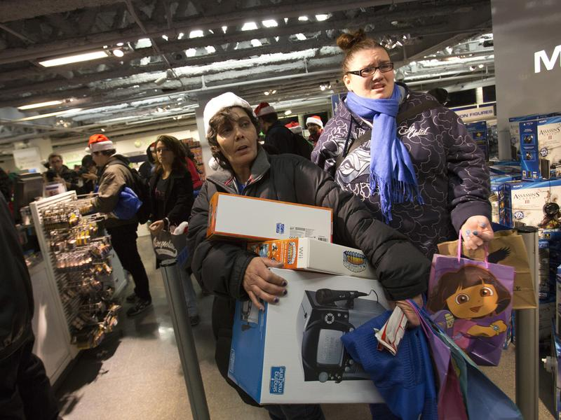 People line up to purchase items at the Black Thursday sale at the Toys 'R' Us store in Times Square on Nov. 22, 2012 in New York City. The store got a head start on the traditional Black Friday sales by opening their doors at 8 p.m. on Thanksgiving night.