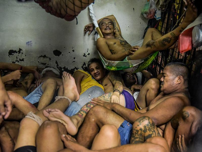 Prisoners sleep inside one of the overcrowded jails in the Tondo district in Manila, Philippines. More than 700,000 suspected narcotics users and dealers have been arrested or turned themselves in since President Rodrigo Duterte announced his war on drugs four months ago. The suspects have overwhelmed the country's jails.