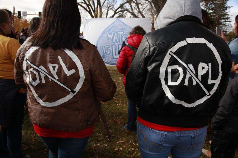 Cousins Jessica and Michelle Decoteau, of Belcourt, both enrolled members in the Turtle Mountain Band of Chippewa, don slogans opposing the Dakota Access Pipeline, Saturday, Oct. 29, 2016, in Bismarck, N.D. The pair, who participated in a peaceful protest outside the North Dakota state capitol, say they stand in solidarity with the Standing Rock Sioux. (John L. Mone/AP)
