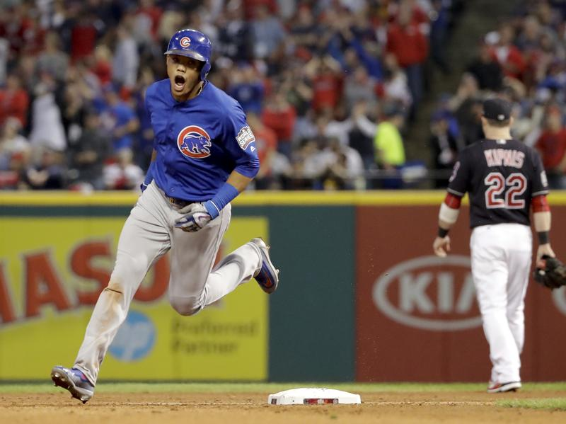 The Chicago Cubs' Addison Russell celebrates after his grand slam against the Cleveland Indians in the third inning of Game 6 of the World Series.