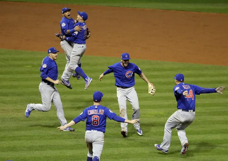 The Chicago Cubs celebrate after Game 7 of the World Series against the Cleveland Indians. (Gene J. Puskar/AP)