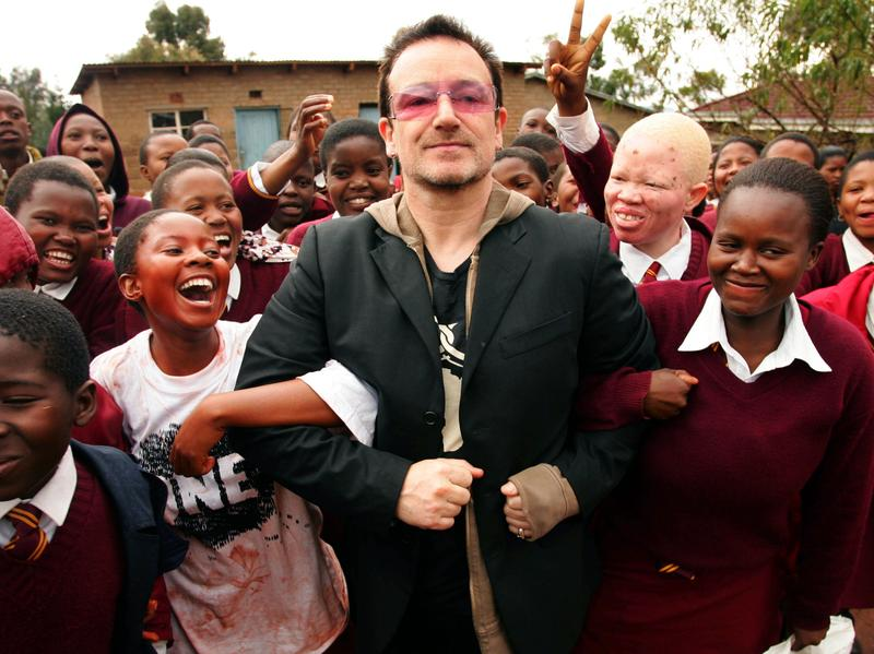 Bono is greeted at a school near Maseru, the capital of Lesotho — part of a 2006 tour to highlight progress in providing treatment to people living with HIV and AIDS.