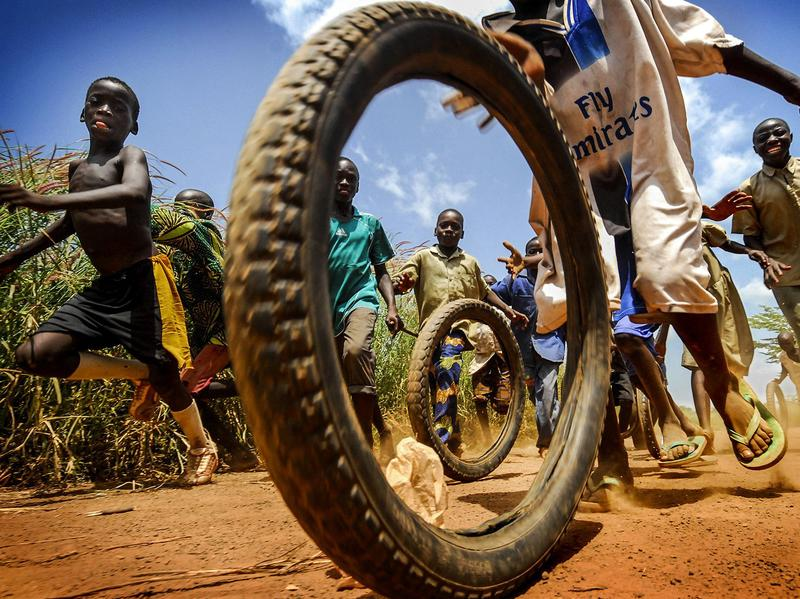 Children play with tires outside a medical center in the West African nation of Togo.