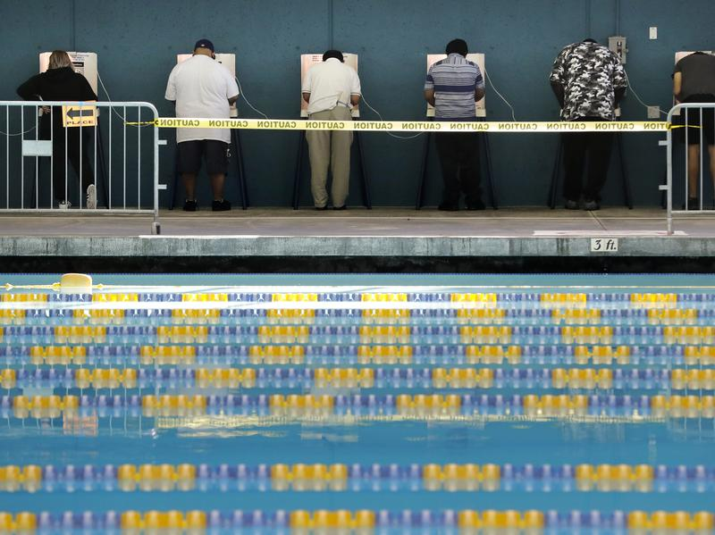 People cast their votes at Echo Park Pool in Los Angeles on Tuesday.