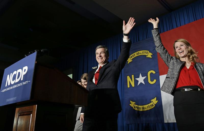 North Carolina Democratic candidate for governor Roy Cooper and his wife Kristin greet supporters during an election night rally in Raleigh, N.C., Wednesday, Nov. 9, 2016. The race between Cooper and Republican Gov. Pat McCrory remains too close to call. (Gerry Broome/AP)