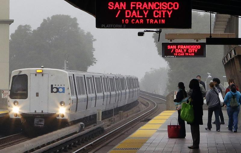 Bay Area Rapid Transit (BART) passengers wait for a train in Oakland, Calif., in October 2013. (Ben Margot/AP)