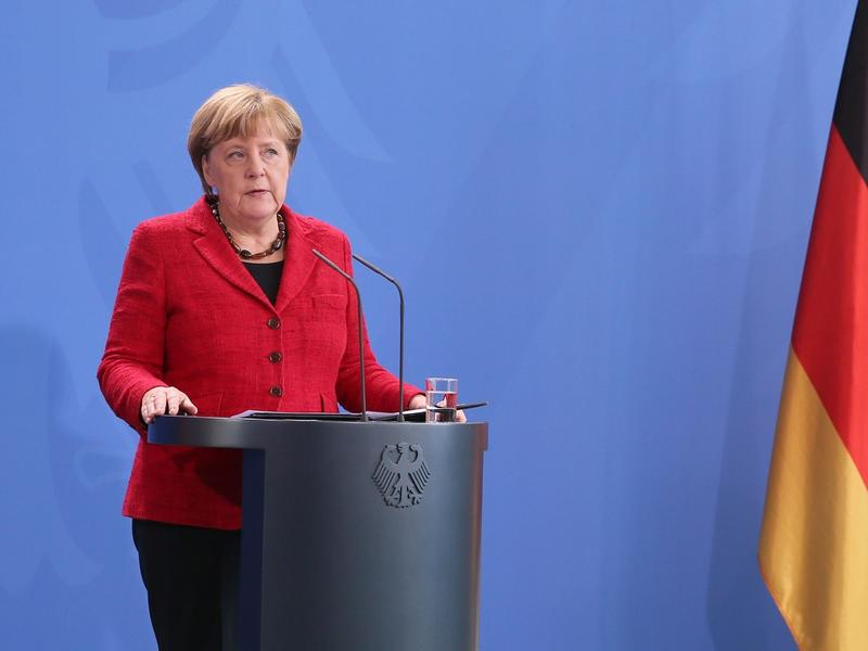 """German Chancellor Angela Merkel speaks on Nov. 9 in Berlin, saying that Germany is prepared to work with a Trump administration that respects """"democracy, freedom"""" and human """"dignity."""""""