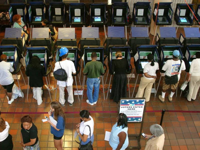 Miami voters make their choices at touch-screen voting machines.