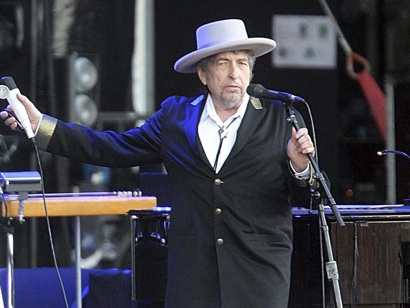 """Bob Dylan, seen performing in 2012, told the Swedish Academy that he had """"pre-existing commitments."""""""