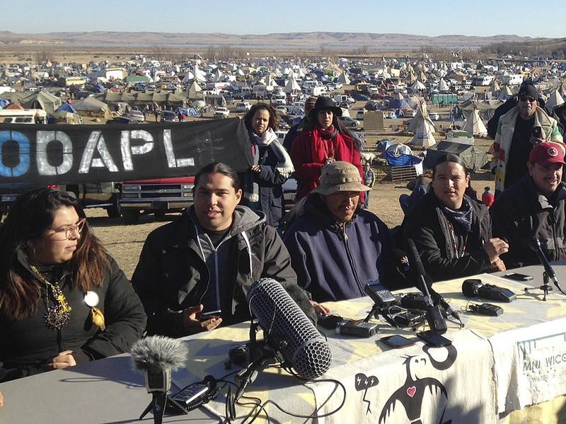 In this Nov. 26, 2016 photo, organizers of protests against construction of the Dakota Access oil pipeline speak at a news conference near Cannon Ball, N.D.