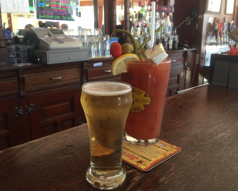 "If you order a Bloody Mary in Wisconsin, you'll probably also get a beer — for free — to ""chase"" the drink. Chasers aren't always as large as those served at the White House in Milwaukee's Bay View neighborhood. (Ann-Elise Henzl/WUWM)"