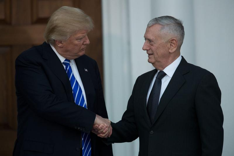 President-elect Donald Trump (left) shakes hands with his selection for defense secretary, retired U.S. Marine Gen. James Mattis, after their meeting at Trump International Golf Club, Nov. 19, 2016 in Bedminster Township, N.J. (Drew Angerer/Getty Images)