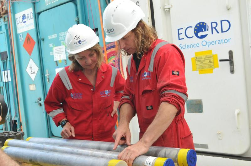 Imperial College London researcher Joanna Morgan (left) and UT researcher Sean Gulick examine a sample from the site of the Chicxulub asteroid site. (Courtesy UT Jackson School of Geosciences)