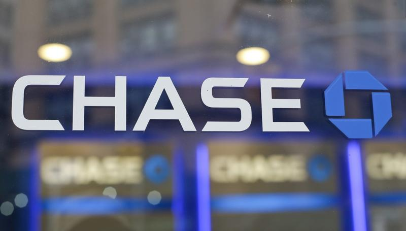 FILE - This Sept. 13, 2014, file photo, shows the Chase bank logo in New York. In an op-ed published Tuesday, July 12, 2016, in the New York Times, JPMorgan Chase said it will give raises to 18,000 tellers, customer service employees, and other workers over the next two years. In the op-ed, JPMorgan Chase Chairman and CEO Jamie Dimon wrote that the bank will raise its minimum pay to a range of $12 to $16.50 an hour, depending on market and location factors. Its current minimum pay is $10.15 an hour. Dimon also wrote that the bank will invest more in training that helps workers get promoted to higher-paying positions. (AP Photo/Frank Franklin II, File)