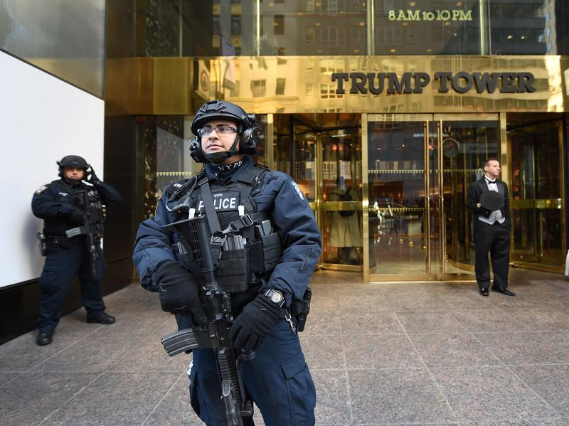 A member of the New York Police Department stands in front of Trump Tower to provide security to President-elect Donald Trump on Nov. 10, in New York.