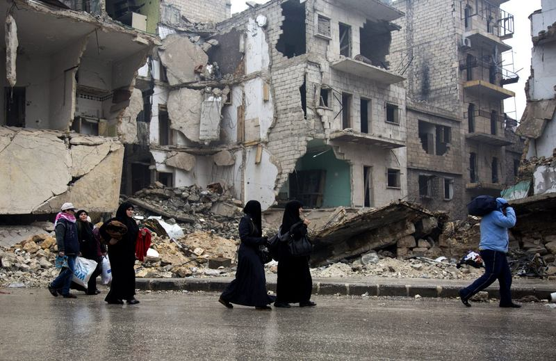 Syrians leave a rebel-held area of Aleppo towards the government-held side on Dec. 13, 2016, during an operation by Syrian government forces to re-take the embattled city. (Karam al-Masri/AFP/Getty Images)