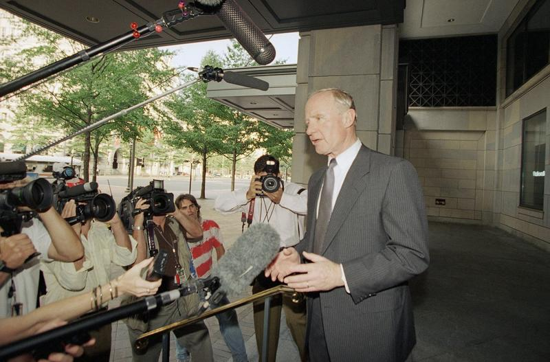 Whitewater special prosecutor Robert Fiske talks to reporters as he arrived at his Washington office on June 30, 1994. Fiske said his first report to the public being released concludes that the death of White House aide Vince Foster in 1993 was a suicide. After Foster's suicide, a conspiracy theory circulated that claimed the former Clinton aide did not take his life, but was killed and the Clintons may have been involved. (Mark Wilson/AP)