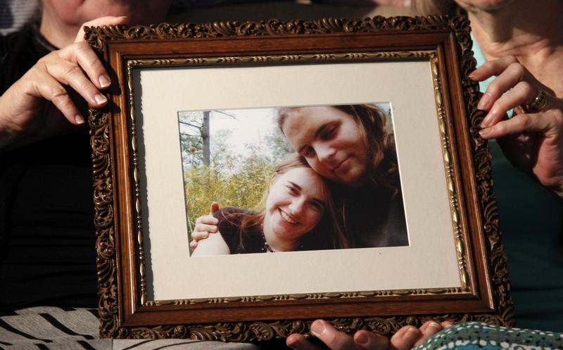 Mother's Linda Boyle, left and Lyn Coleman hold photo of their married children, Joshua Boyle and Caitlan Coleman, who were kidnapped by the Taliban in late 2012, Wednesday, June 4, 2014, in Stewartstown, Pa. (Bill Gorman/AP)