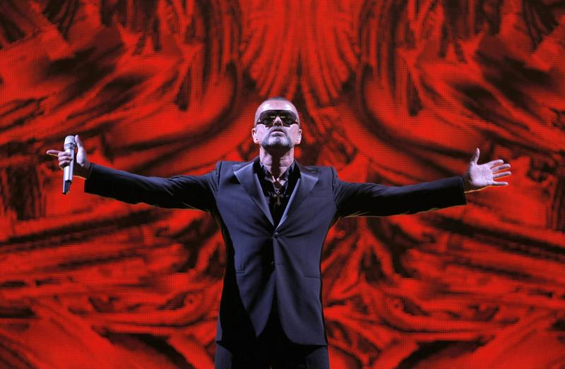In this Sept. 9, 2012 file photo, British singer George Michael performs at a concert to raise money for the AIDS charity Sidaction, during the Symphonica tour at Palais Garnier Opera house in Paris, France. (Francois Mori, File/AP)