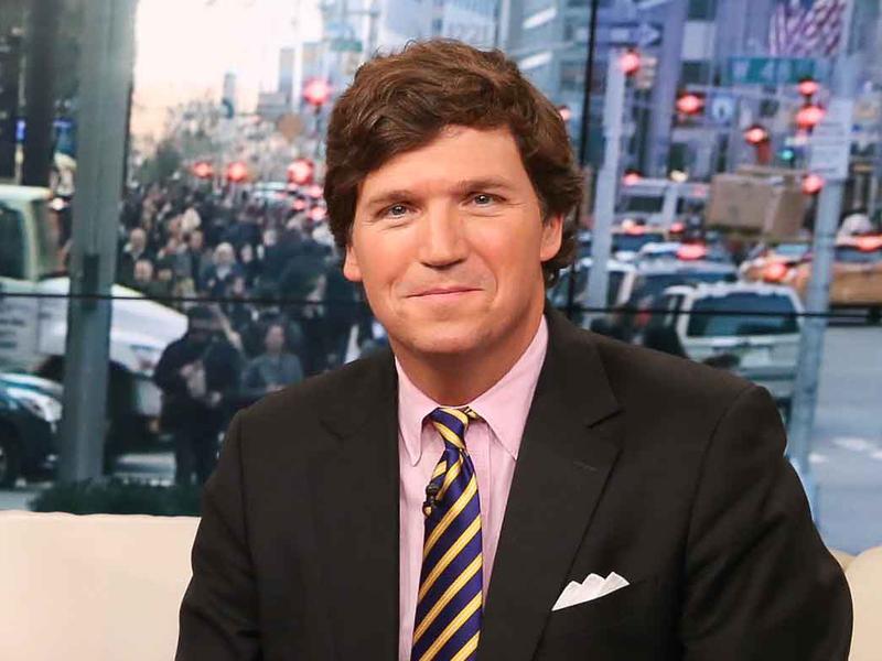 Tucker Carlson appears on <em>Fox & Friends</em> at Fox Studios in New York City in 2015.