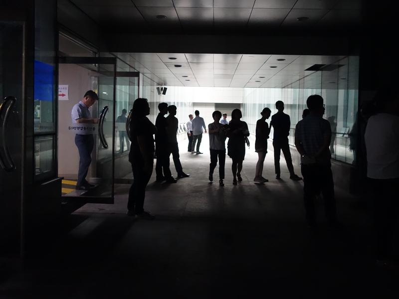 Workers in Seoul's Yongsan ward office wait in a parking garage for an all-clear sign during a recent air raid drill. Concerned about a possible attack by North Korea, the South Koreans hold the drills twice a year.