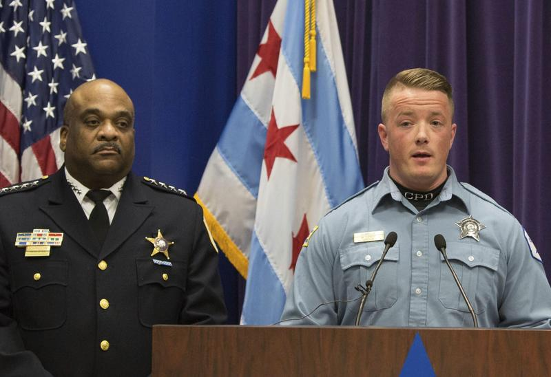 Chicago Police Officer Mike Donnelly, accompanied by Police Superintendent Eddie Johnson, left, speaks at a news conference Thursday, Jan. 5, 2017, in Chicago. Johnson said four black people have been charged with hate crimes in connection with a video broadcast live on Facebook that showed an assault on a mentally disabled white man. Donnelly was one of the first officers on the scene. (Teresa Crawford/AP)
