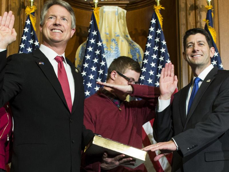 House Speaker Paul Ryan administers the House oath of office to Rep. Roger Marshall, R-Kan., on Capitol Hill as his son dabs.
