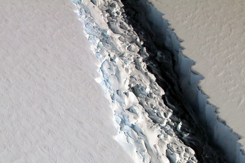 This Nov. 10, 2016 aerial photo released by NASA, shows a rift in the Antarctic Peninsula's Larsen C ice shelf. According to NASA, IceBridge scientists measured the Larsen C fracture to be about 70 miles long, more than 300 feet wide and about a third of a mile deep. (John Sonntag/NASA via AP)