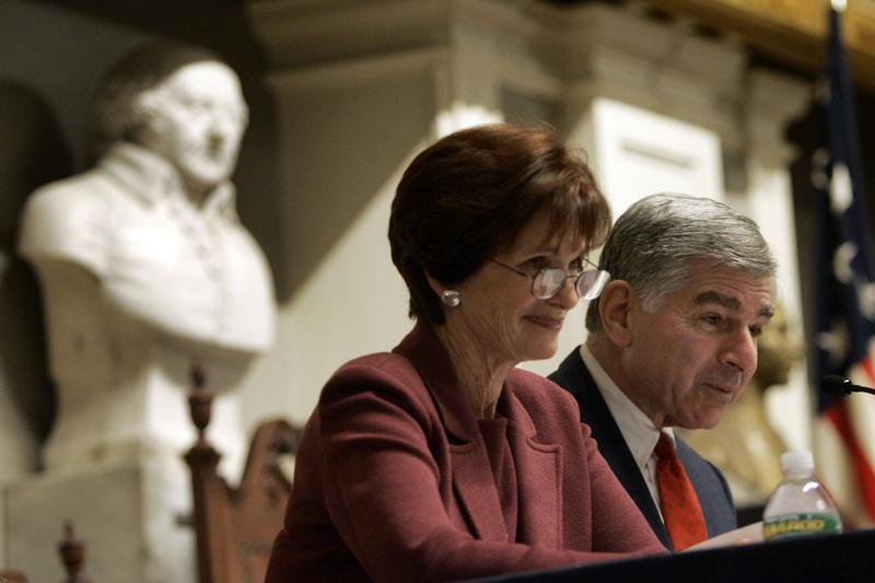 Former Massachusetts Gov. Michael Dukakis and his wife, Kitty, smile as they read letters between John Adams and his wife, Abigail, during a Massachusetts Historical Society program at Faneuil Hall in Boston. (Elise Amendola/AP)