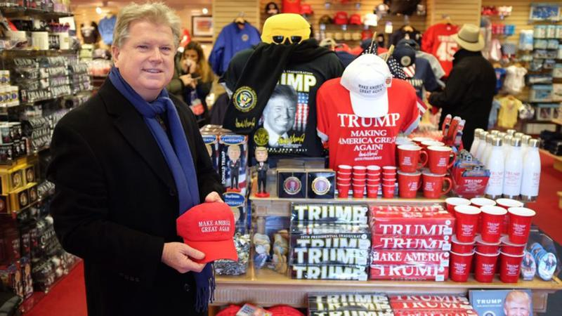 Jim Warlick of White House Gifts has been stocking up on Trump swag in preparation for the inauguration. (Patrick Madden/WAMU)
