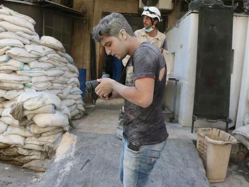 "Khaleed Khateeb, 21, was the videographer for the Netflix documentary <em>The White Helmets</em>. ""This photo was after double tap of aircraft on July 27, 2014,"" he says, referring to an airstrike followed by another attack. ""I don't know how I survived."""