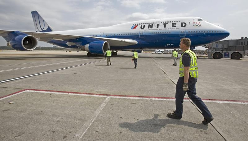 United Airlines flight #897, a Boeing 747, at Washington's Dulles International Airport waits for it's maiden non-stop 13-hour flight from Washington to Beijing on March 28, 2007. (Paul J. Richards/AFP/Getty Images)