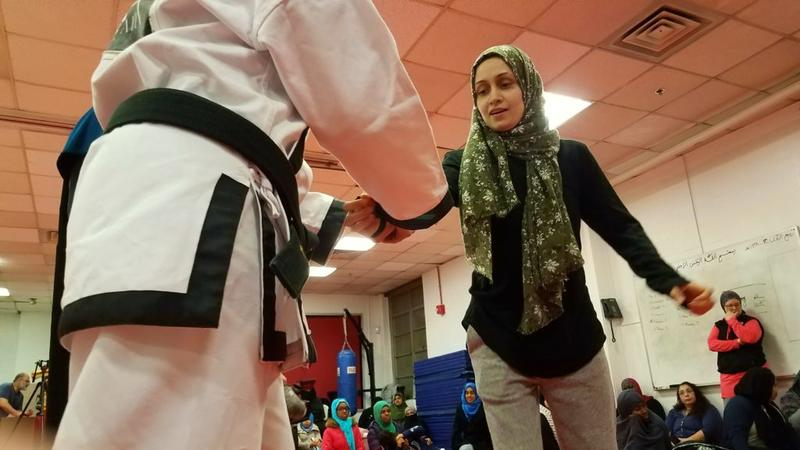 Iram Baig practices with an instructor during a self-defense course for Muslim women in College Park, Md. (Carmel Delshad/WAMU)