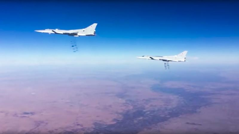 This photo provided by the Russian Defense Ministry Press Service shows Russian air force Tu-22M3 bombers strike the Islamic State group wldtargets in Syria on Tuesday, Jan. 24, 2017. (Russian Defense Ministry Press Service Photo via AP)