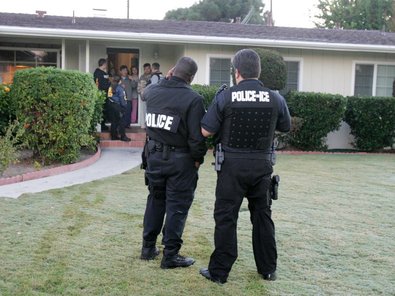 President Donald Trump's executive order on immigration broadened the category of immigrants who the government considers a priority for deportation. In this file photo, immigration agents conduct an arrest in Southern California.