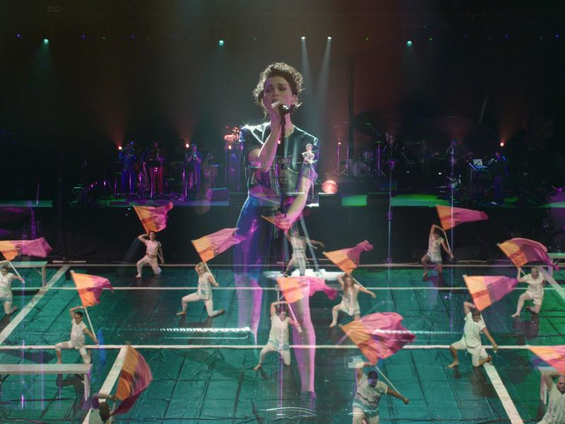 St. Vincent performs in tandem with a color guard team at the Barclays Center on June 27, 2015.