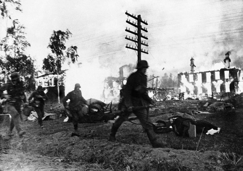German troops advance through a blazing Leningrad suburb, in Russia on Nov. 24, 1941. (AP)
