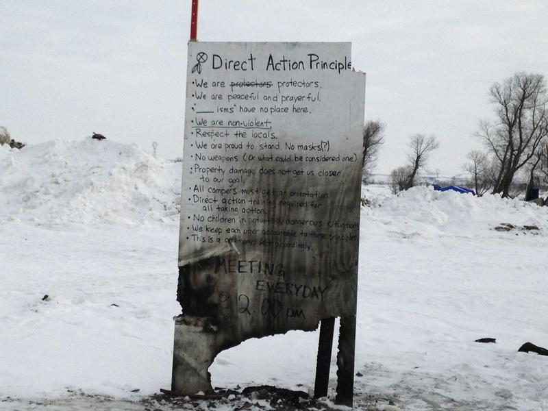 A sign is seen at an encampment set up near Cannon Ball, N.D., Wednesday, where opponents are protesting the construction of the Dakota Access pipeline.