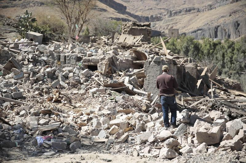 A man walks amid the rubble of a house destroyed by a Saudi-led airstrike on the outskirts of Sanaa, Yemen. (Hani Mohammed/AP)