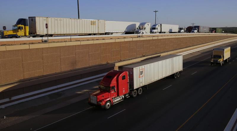 Trucks move along Interstate 35, in Laredo, Texas, in November 2016. President Trump's campaign promise to abandon the North American Free Trade Agreement helped win over Rust Belt voters who felt left behind by globalization. But the idea is unnerving to many people in cities on the U.S.-Mexico border. (Eric Gay/AP)