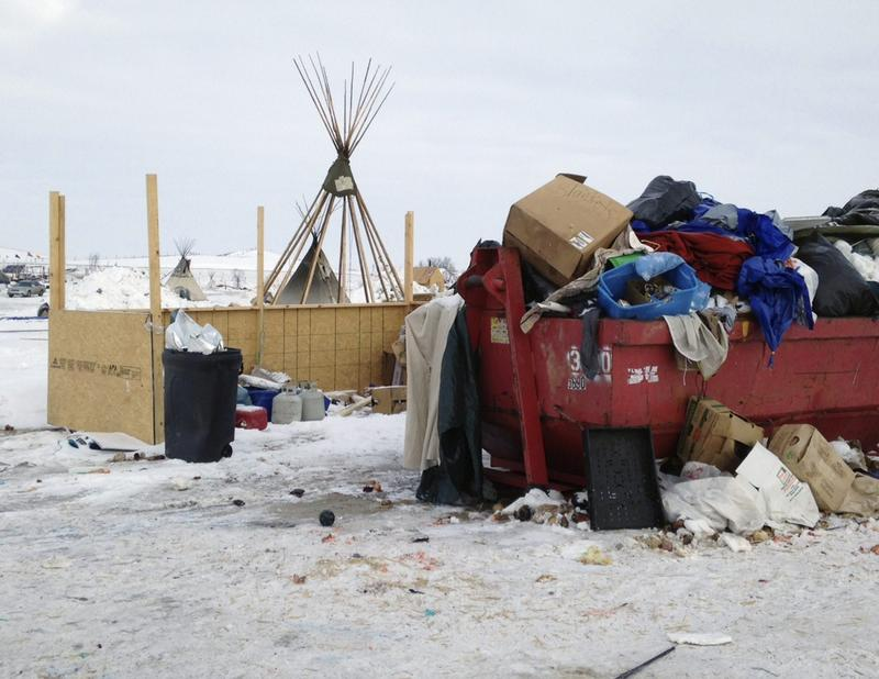 Trash is seen piled in a dumpster at an encampment set up near Cannon Ball, N.D., Wednesday, Feb. 8, 2017, for opponents against the construction of the Dakota Access pipeline. (James MacPherson/AP)