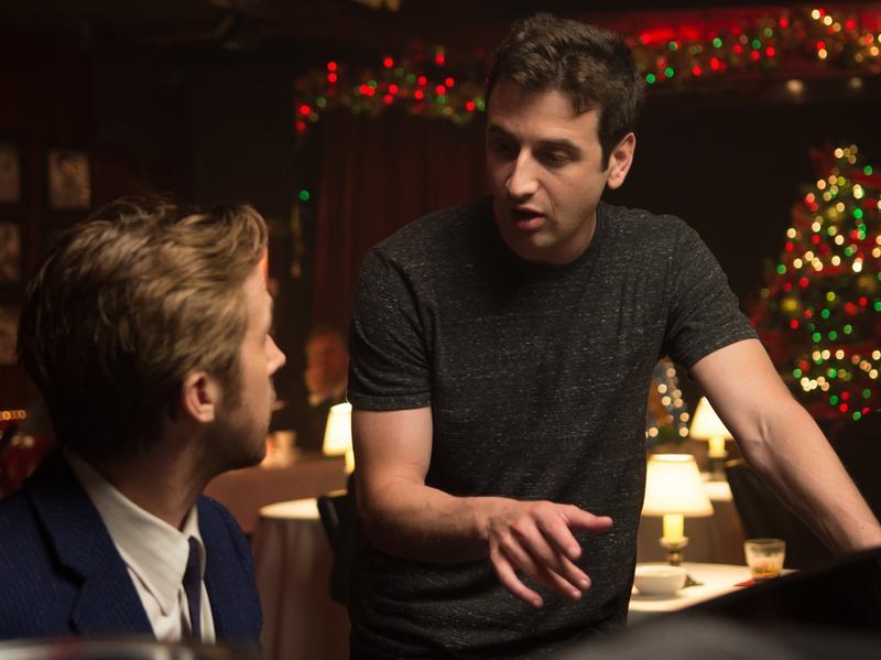 <em>La La Land</em> composer Justin Hurwitz on set with star Ryan Gosling.