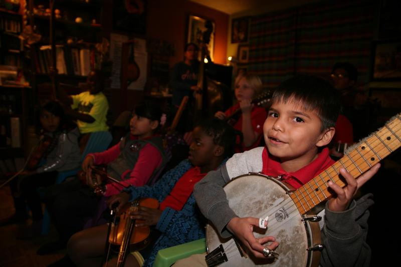 The Jam Pak Blues 'N' Grass Neighborhood Band has been making music together since 1994. So far, about 200 kids have gone through the band, though many never really leave, even when they grow up. (Stina Sieg/KJZZ)