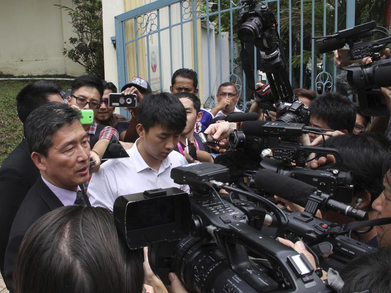 Ri Tong Il (left), former North Korean deputy ambassador to the United Nations, speaks to reporters on Tuesday outside the North Korean Embassy in Kuala Lumpur, Malaysia.
