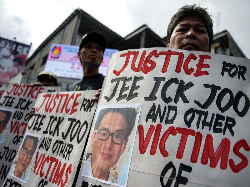 Activists protest at the headquarters of the Philippine National Police, condemning the government's war on drugs and holding placards showing murdered South Korean businessman Jee Ick-joo. The South Korean businessman was allegedly kidnapped by Philippine policemen under the guise of a raid on illegal drugs and murdered at the national police headquarters in Manila, authorities said.