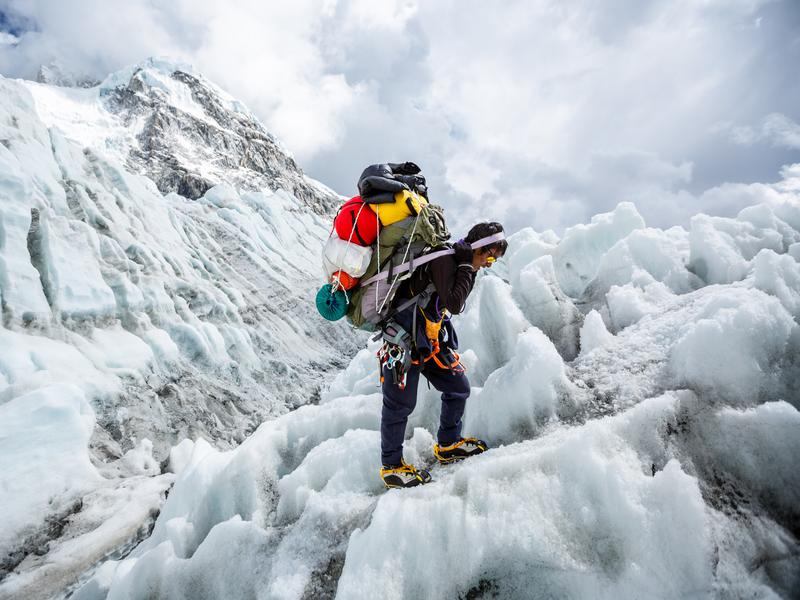 A sherpa on the Khumbu Ice Fall — an obstacle faced on Mt. Everest.
