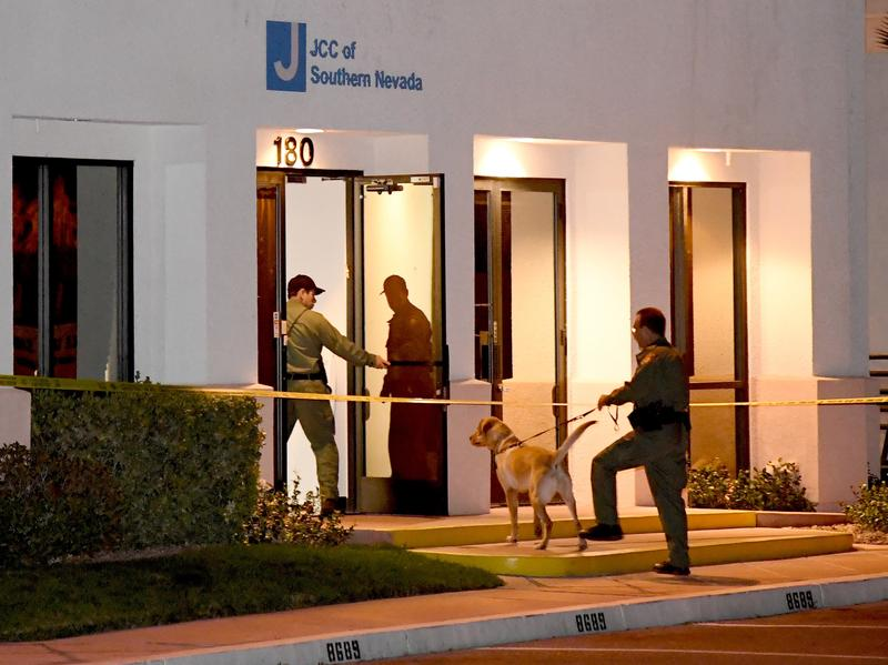 Las Vegas Metropolitan Police Department K-9 officers search the Jewish Community Center of Southern Nevada after an employee received a suspicious phone call that led about 10 people to evacuate the building on Feb. 27. Jewish institutions across the nation have received more than 120 bomb threats in the past two months