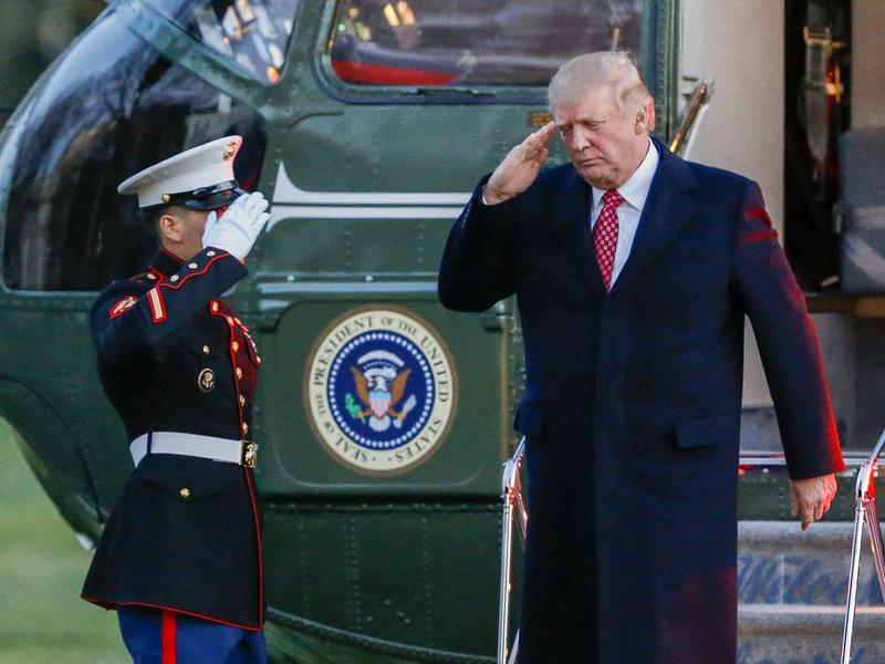 President Trump salutes as he disembarks Marine One on the South Lawn of the White House on Sunday. Trump signed a new executive order on travel and refugee resettlement on Monday.