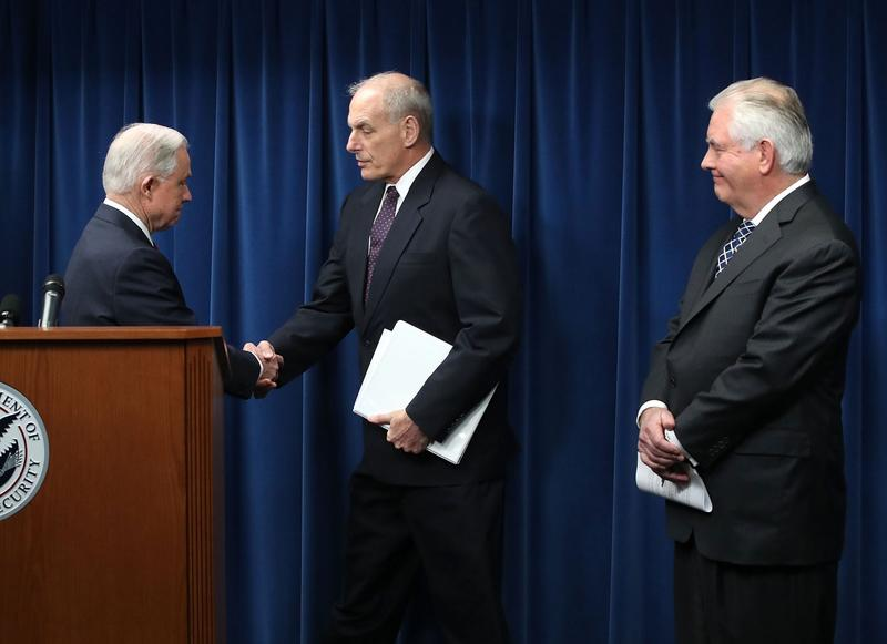 Attorney General Jeff Sessions (left), Secretary of Homeland Security John Kelly (center) and Secretary of State Rex Tillerson take part in a news conference about issues related to a reconstituted travel ban at the U.S. Customs and Borders Protection headquarters, on March 6, 2017 in Washington. Earlier today, President Donald Trump signed an executive order that excludes Iraq from the blacklisted countries but continues to block entry to the U.S. for citizens of Somalia, Sudan, Syria, Iran, Libya and Yemen. (Mark Wilson/Getty Images)